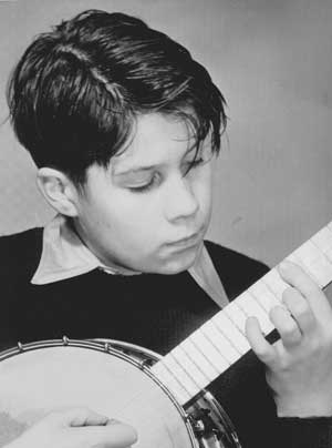 Young Ron playing the banjo